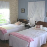 The porch room is sunny and beautiful, with 4 single beds (perfect for teens)!