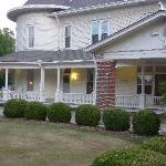 Old fashion wrap around porch w/rocking chairs