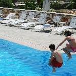  kids playing at the swimming pool