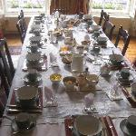The breakfast table set for our group