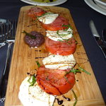 Caprese salad (dipping oil for bread in background)
