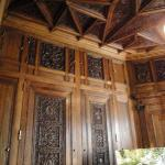 The intricate wood carvings in the study