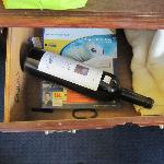We open the drawer and found that old bottle of wine laying there!!!
