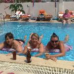 chilling out in the pool with some friends and a cold beer