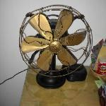 Antique working GE fan in the room