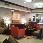 "Feel at home in our lobby. Sit and read a book or watch the 32"" television over the doublesided"