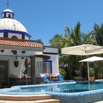 The beautiful infinity pool with waterfall is the center of our Old Hacienda Style Inn