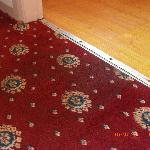  Sodden carpet beside bathroom