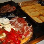 Steak, bread, fresh mozza, prsut, roasted peppers from supermarket, herbs from backyard