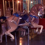 Hand carved cowboy themed horse, city park carousel