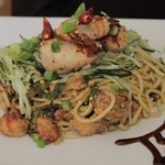 seared scallops and shrimp over a lo mein of lobster, chili peppers and scallion
