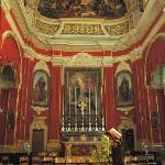 Gozo - hanging red tapestries for the Feast of the Sacred Heart