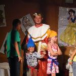 my husband as prince charming in the show and the kids dressed as dwar