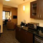 Guest suites have web bars with mini-refrigerator, microwave, and coffee maker
