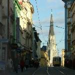 View of St Wenceslas' tallest spire along busy Denisova ul. (street)