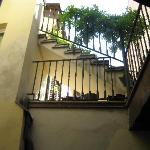 The indoor courtyard and stairwell to our room.