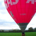 The stunning red balloon brings us gently down in a field near Cheddar.