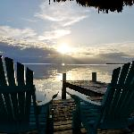 Sunrise over Green Parrot dock - view from beach in front of cabana