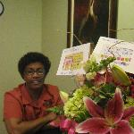 Nedra Jefferson at the Water Street Hotel's front desk with her Bouquet of Thanks
