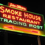 The symbol and trademark of the Smoke House all these years shows up brightly after dark