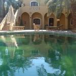 """Swimmng pool """" it is a pool around a natural well"""""""