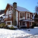 Main house in winter with snow