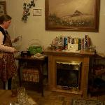  A cozy fireplace, a nice selection of books, and even an apron to wear when making your food