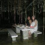 Feet in water dining experience
