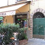Door to Alla Dolce Vita- Entrance is located to the right of a Cafe
