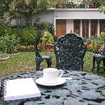  Tables in the garden: sounds include ringing of rickshaw bells and lots of birds, some horns and