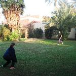 Kids playing soccer on guesthouse lawn
