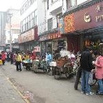 side street lined with morning snack vendors