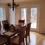  The view of the dining room taken from the kitchen, overlooks the woods