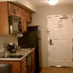 Kitchen area and room door.