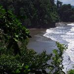 The semi-private black sand beach
