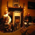 The cosy lounge at Stromeferry - completewith natural fuel burner and tartan blanket style curta