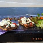 Goat cheese on brushetta with eggplant