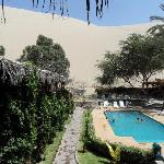 Pool area with huge sand dune in background