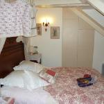 smallish bedroom decorated with owner's linen handiwork