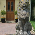 The lion at the entrance to our driveway