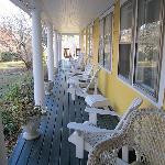  the long porch surrounds the inn
