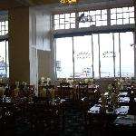 Restaurant seating, some tables with a sea view.