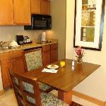 The kitchen area of the suite, with stove and full size fridge.