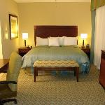 The luxurious King Bed in our suites.