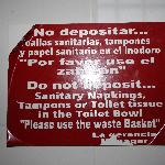 Sign in bathroom about toilet paper