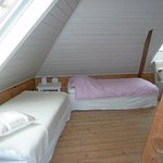  We stayed in the attic which has a queen bed and 2 singles