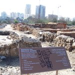 Ancient village with modern Tel Aviv in the background