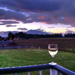 enjoying a glass of wine overlooking a quiet sunset