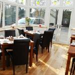 In the morning, enjoy a delightful breakfast in our conservatory.