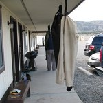 Outside of rooms with waders drying after fishing.